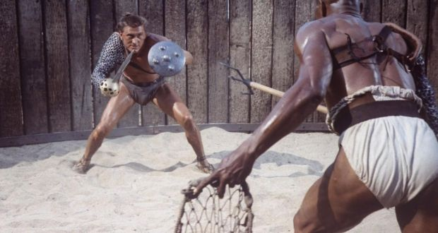 Actor Kirk Douglas holding shield and sword as he faces actor Woody Strode (as Draba), in scene from Stanley Kubrick's film Spartacus. Photograph: JR Eyerman//Time Life Pictures/Getty