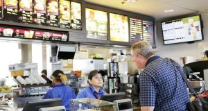 A customer at a McDonald's counter. Phortograph: Getty Images