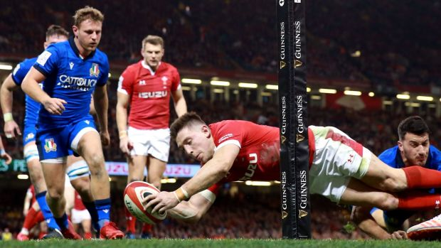 Josh Adams dives to score one of his brace of tries against Italy. Photograph: Adam Davy/PA