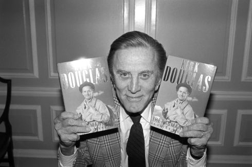Kirk Douglas with copies of his autobiography The Ragman's Son at Harrods Department Store in London in September 2008. Photograph: PA