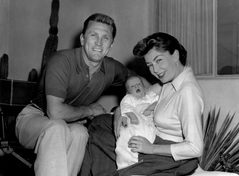 Kirk Douglas with his wife Anne Buydens and their son Peter Vincent, circa 1963.  Photograph: Keystone/Getty Images