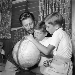 With his sons Joel (centre) and Michael in 1956. Photograph: Arnold M. Johnson/Hulton Archive/Getty Images
