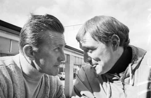 Kirk Douglas and Irish actor Richard Harris on the set of  Heroes of Telemark, in March 1965. Photograph: Larry Ellis/Express/Getty Images