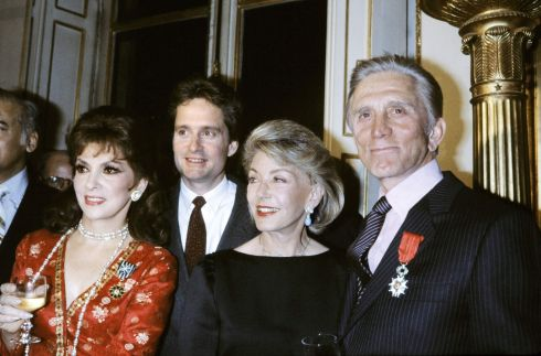 Kirk Douglas, with his wif Anne and son Michael,  after being awarded Chevalier of the French Legion d'Honneur in March 1985. On the far left is Italian actress Gina Lollobrigida who was awarded Officer of the Order of Arts and Letter. Photograph: Georges Bendrihem/AFP/Getty Images