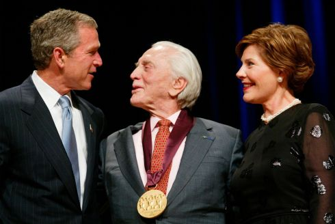 US presidemt GW Bush and First Lady Laura Bush with Kirk Douglas at the National Endowment for the Arts National Medal of Arts Awards ceremony in Washington. Photo: Pablo Martinez Monsivais/AP