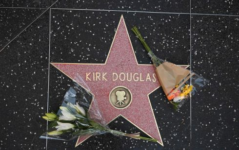 Flowers are placed on the star of late actor Kirk Douglas on the Walk of Fame in Hollywood, California.  Photograph: Robyn Beck/ AFP/Getty Images