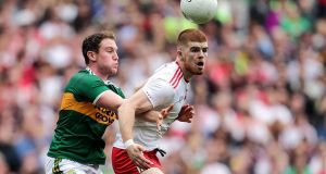 Cathal McShane: his decision to remain  in Tyrone will be a significant boost  for Mickey Harte's squad. Photograph: Laszlo Geczo/Inpho