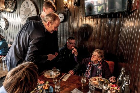 DO THE ROUNDS: Fianna Fáil leader Micheál Martin meets 94-year-old Kathleen Findlay while canvassing in McCarthy's pub in Youghal, Co Cork. Photograph: Michael Mac Sweeney/Provision