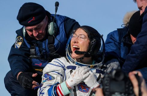 DOWN TO EARTH: Nasa astronaut Christina Koch reacts shortly after the landing of the Russian Soyuz MS-13 space capsule in Kazakhstan. Photograph: Sergei Ilnitsky/Pool/EPA