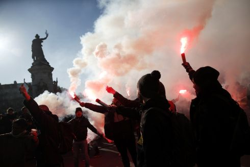 FRANCE PROTESTS: Protesters light flares as they participate in a demonstration against pension reforms in Paris, France. Photograph: Yoan Valat/EPA