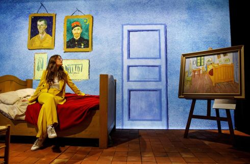 ALL GOGH: An employee poses with a recreated scene depicting a bedroom belonging to artist Vincent Van Gogh, during a photocall in London, Britain. Photograph: Tolga Akmen/AFP via Getty Images