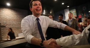 Democratic presidential hopeful Pete Buttigieg in Hampton, New Hampshire, the morning after the flawed Iowa caucus.  If successful  he would be the first openly gay presidential candidate. Photograph: Spencer Platt/Getty Images