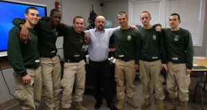 Brian O'Nuanain (centre) is from Cork City and now lives in Louisiana where he works with the US military, the National Guard. Here he is with some recruits