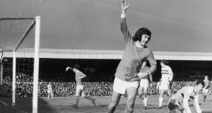 Manchester United's George Best celebrates after opening the scoring against Northampton in their FA Cup tie in 1970. Photo: Michael Webb/Keystone/Getty Images