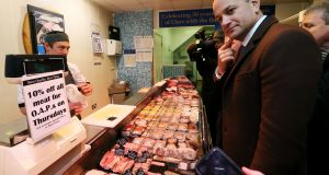 Taoiseach Leo Varadkar buys more sausages in Ennis, Co Clare.  We can only hope somebody remembered to clear all the meat out of the BMW's boot. Photograph: Brian Lawless/PA Wire