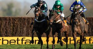 Nico de Boinville riding Altior (left) clear the last to win The Win Bigger On The Betfair Exchange Chase from Sceau Royal and Tom Bellamy (green) at Newbury. Photograph:  Alan Crowhurst/Getty Images