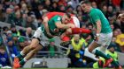 Ireland's Andrew Conway tackles Wales' Ken Owens during the match at the Aviva Stadium. Photo: Donall Farmer/PA Wire.