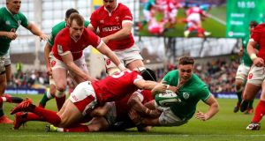 Ireland's Jordan Larmour scores the first try of the game. Photograph: Ryan Byrne/Inpho