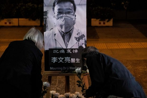 People pay respects at a memorial to Li Wenliang, who was silenced by the police for being one of the first to warn about the coronavirus in Hong Kong on February 7th. Photograph: Lam Yik Fei/The New York Times