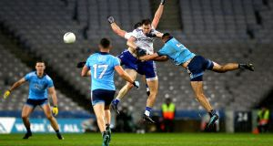 Dublin's James McCarthy with Karl O'Connell and Dessie Ward of Monaghan. Photo: Ryan Byrne/Inpho