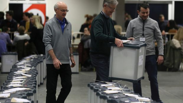 A count staff member carries a ballot box before votes are counted at a counting centre in Citywest on Sunday. Photograph: Lorraine O'Sullivan/Reuters