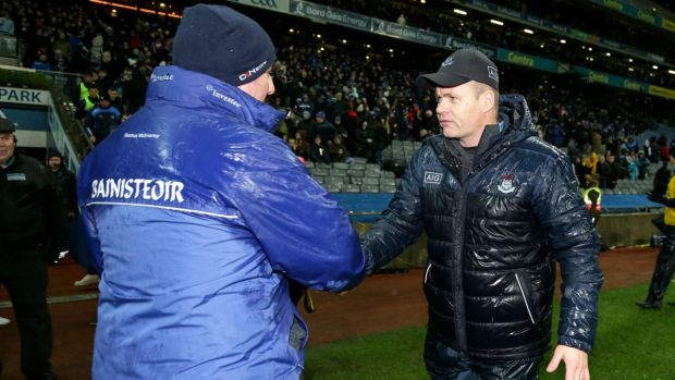Monaghan manager Séamus McEnaney shakes hands with Dublin counterpart Dessie Farrell after the game. Photograph: Laszlo Geczo/Inpho