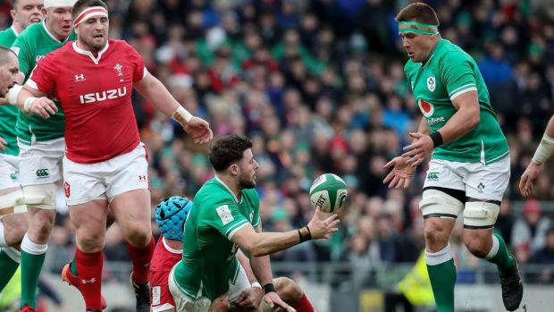 Robbie Henshaw offloads to CJ Stander during the game against Wales. Photograph: Bryan Keane/Inpho