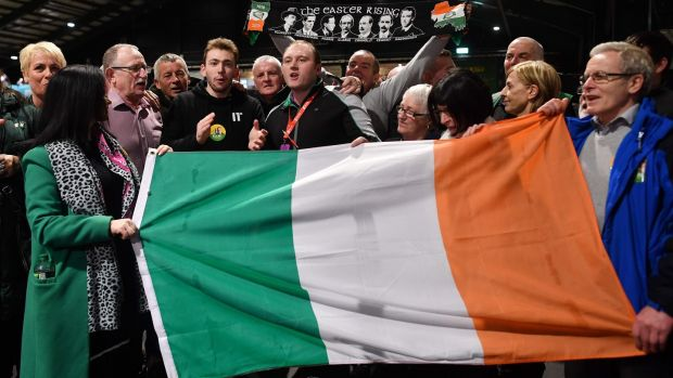 Sinn Féin party supporters sing as they hold a flag during the count in the RDS centre in Dublin. Photograph: Ben Stansall/AFP via Getty Images