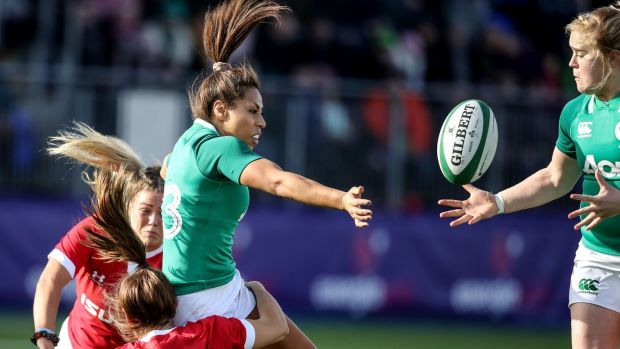 Ireland's Sene Naoupu offloads to Cliodhna Moloney after being tackled by Kerin Lake and Kelsey Jones of Wales. Photograph: Dan Sheridan/Inpho