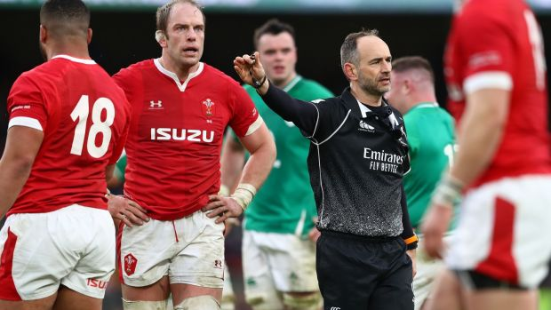 Romain Poite and Wales captain Alun Wyn Jones. Photograph: Michael Steele/Getty
