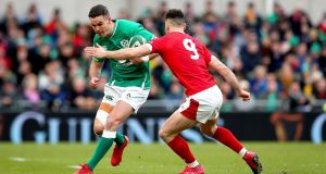 Johnny Sexton tries to step Tomos Williams during Ireland's win over Wales. Photograph: Ryan Byrne/Inpho