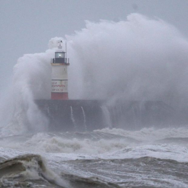 Waves crash against the lighthouse in Newhaven as Storm Ciara pummels the British coast. Photograph: Andrew Matthews/PA Wire