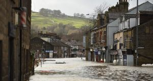 Flood water covers the roads in Mytholmroyd, northern England as Storm Ciara swept over the country. Photograph: Oli Scarff/AFP via Getty