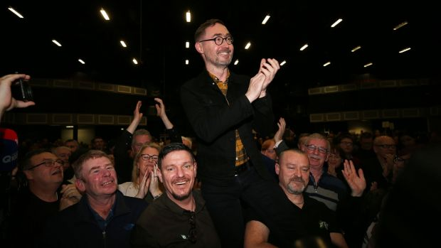 Sinn Féin's Eoin Ó Broin celebrating with colleagues and family after being elected in Dublin Mid West. Carrying him aloft, to his left, is fellow candidate Mark Ward, who has also been elected in the constituency. Photograph: Nick Bradshaw