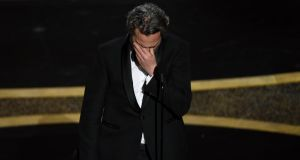 Oscars 2020: Joaquin Phoenix on stage at the Dolby Theatre on Sunday night. Photograph: Chris Pizzello/AP Photo