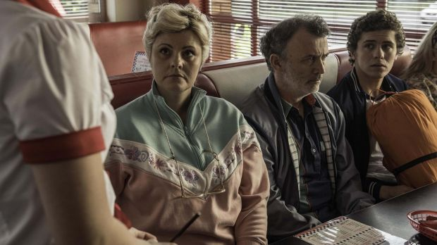 Tara Lynne O'Neill as Mary 	Quinn, Tommy Tiernan as Gerry Quinn and Dylan Llewellyn as James Maguire in Derry Girls.