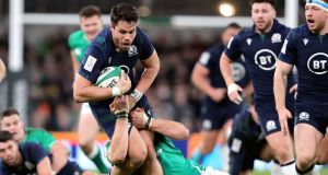 Sean Maitland is tackled by Iain Henderson during Scotland's defeat to Ireland. Photograph: Niall Carson/PA