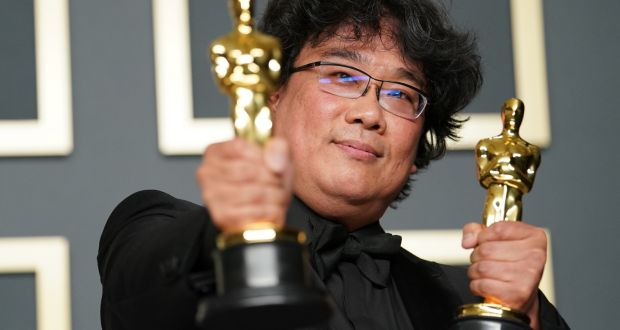 Bong Joon Ho, winner of the Original Screenplay, International Feature Film, Directing, and Best Picture awards for Parasite. Photograph:  Rachel Luna/Getty Images
