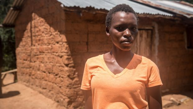 "Brenda Mwatha (20): the locusts stayed on her family's land in Kambirwa for two days. ""They almost covered the visibility of the sky."" Photograph: Sally Hayden"