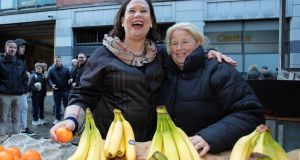 Sinn Fein party leader Mary Lou McDonald  as she meets  a fruit seller during a walk about in the centre of Dublin. Photograph: Paul Faith/AFP/Getty