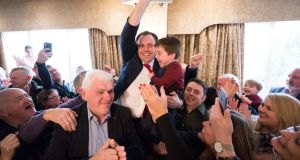 Cathal Crowe (Fianna Fáil) celebrates with his son Sam after being elected at the Co Clare Count at the falls Hotel, Ennistymon on Monday afternoon. Photograph: Eamon Ward