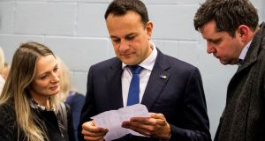 Taoiseach Leo Varadkar at Phibblestown Community Centre in Dublin with Emer Currie  and Ted Leddy. Photograph: Liam McBurney/PA Wire