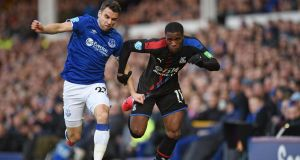Seamus Coleman battles with Wilfried Zaha during Everton's win over Crystal Palace. Photograph: Oli Scarff/Getty/AFP
