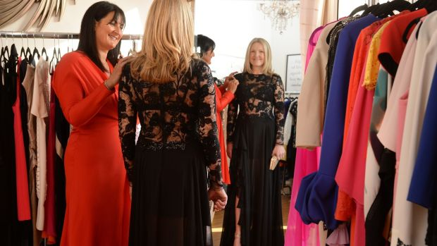 Owner Rhoda McDonagh helps Fiona Mullan as she tries on a dress at Designer Room. Photograph: Dara Mac Dónaill