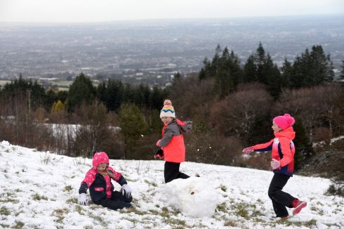 FEBRUARY FUN: Sisters Aoibhe, Shona and Cara Heaney, from Rathfarnham, enjoy the snow in Killakee in the Dublin Mountains. Photograph: Dara Mac Dónaill