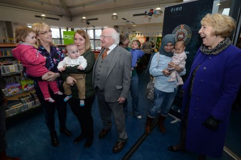 BOOK LOVERS: Michael D Higgins and his wife Sabina meeting members of Cabra parent-and-toddler group, from left, Katherine Brenning and granddaughter Frankie, Eileen Khalfaoui and baby Hassen, Adrienne Lynch and baby Terri Lynch and Maya Andayani and Baby Kira, at an event in Cabra Library to mark his donation of his personal book collection to Dublin City Libraries. Photograph: Alan Betson