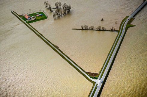 FLOOD PLAIN: An aerial photograph from a drone shows the flooded Noordwaard Polder at the Biesbosch in Werkendam, Netherlands. The Noordwaard area collects flood water from the river Boven Merwede.  Photograph: Rob Engelaar/EPA