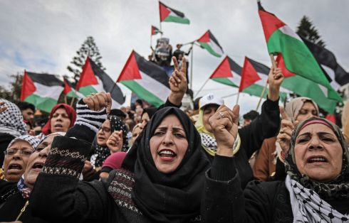PEACE PLAN REJECTED: Palestinian protesters wave national flags during a Gaza City demonstration against the peace plan of US President Donald Trump. Palestinian president Mahmud Abbas dismissed the plan on Tuesday at the UN Security Council, as as a gift to Israel and unacceptable to Palestinians. Photograph: Mahmud Hams/AFP/Getty