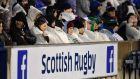Supporters shelter from the rain during the Six Nations clash between Scotland and England at Murrayfield. Photograph: Getty Images