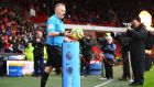 Referee Jon Moss picks up the match ball prior to the Premier League match between Sheffield United and AFC Bournemouth at Bramall Lane. Photograph: Getty Images